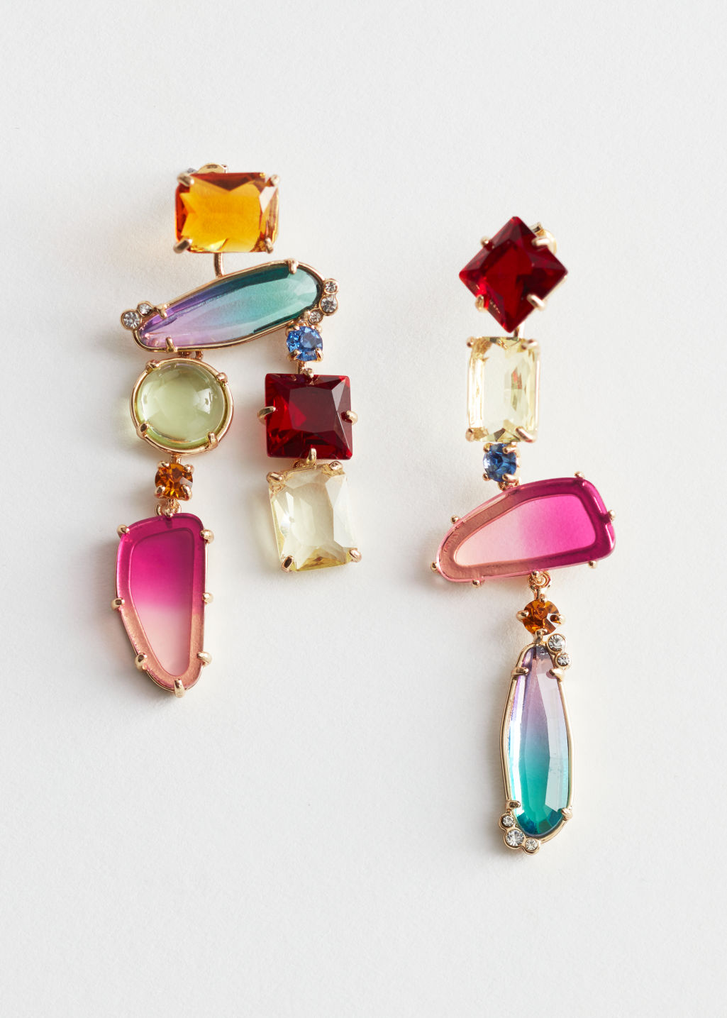 Front image of Stories rainbow rhinestone hanging earrings in red