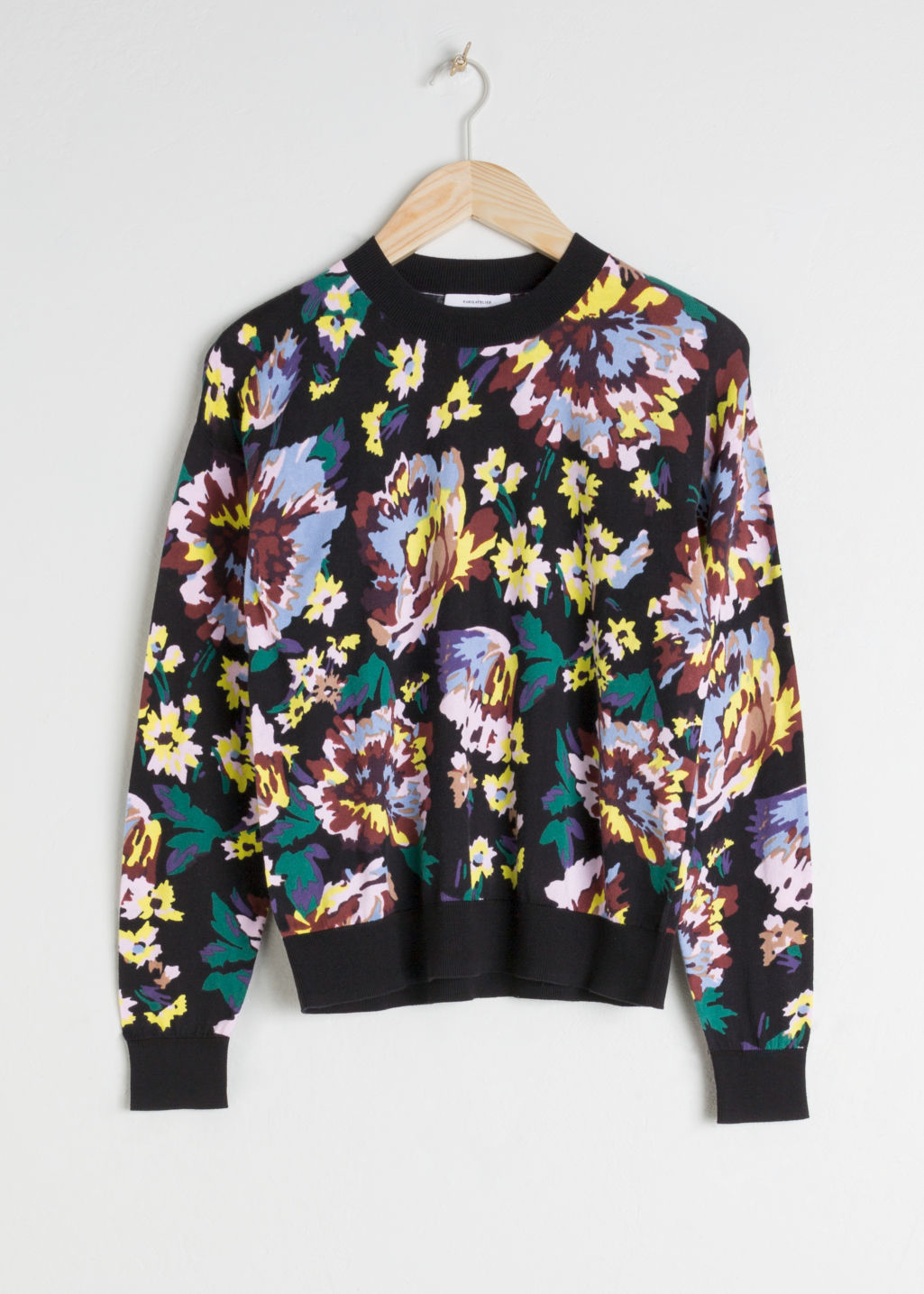 Front image of Stories floral cotton knit sweater in black