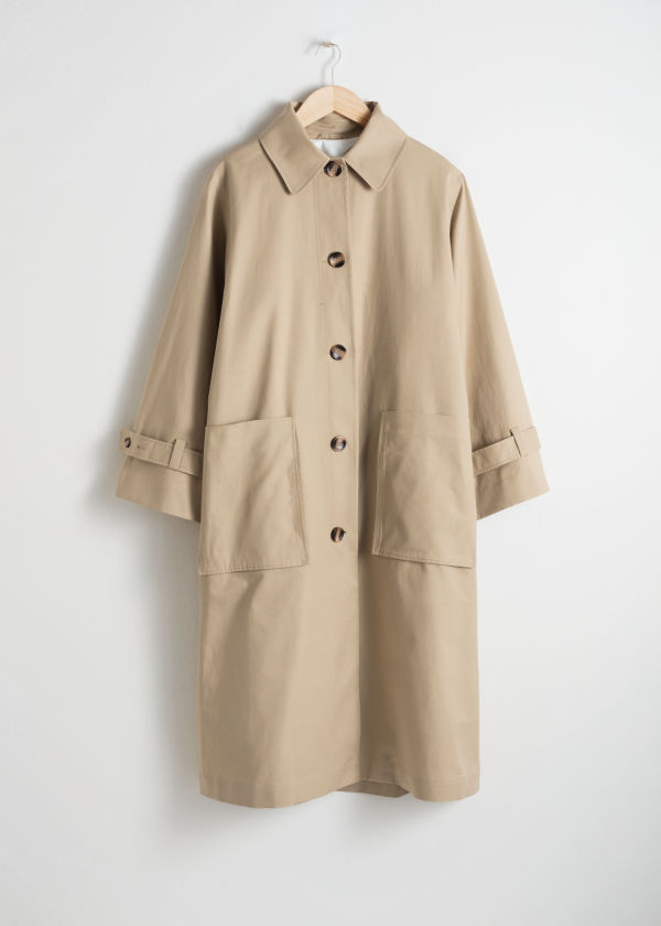 Front image of Stories oversized utilitarian trenchcoat in beige