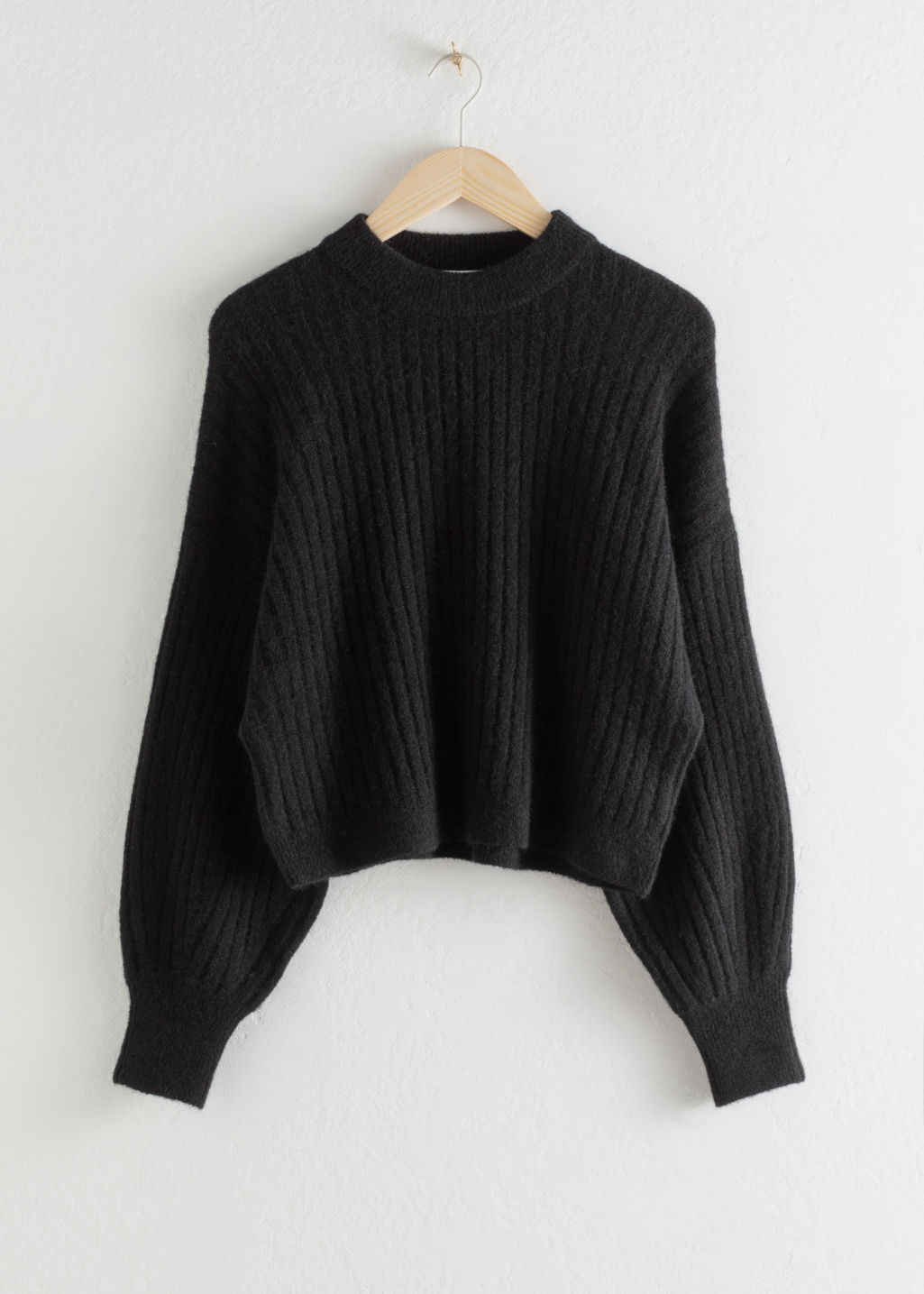 Front image of Stories alpaca blend knit sweater in black