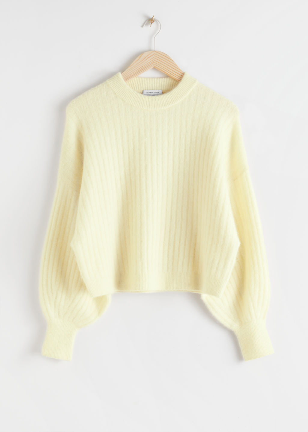 Front image of Stories alpaca blend knit sweater in yellow