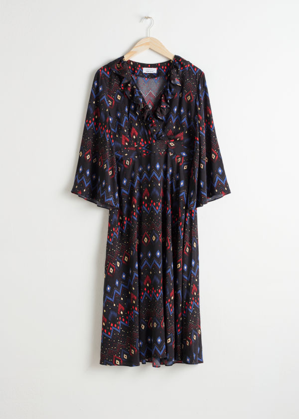Front image of Stories plunging printed midi dress in black