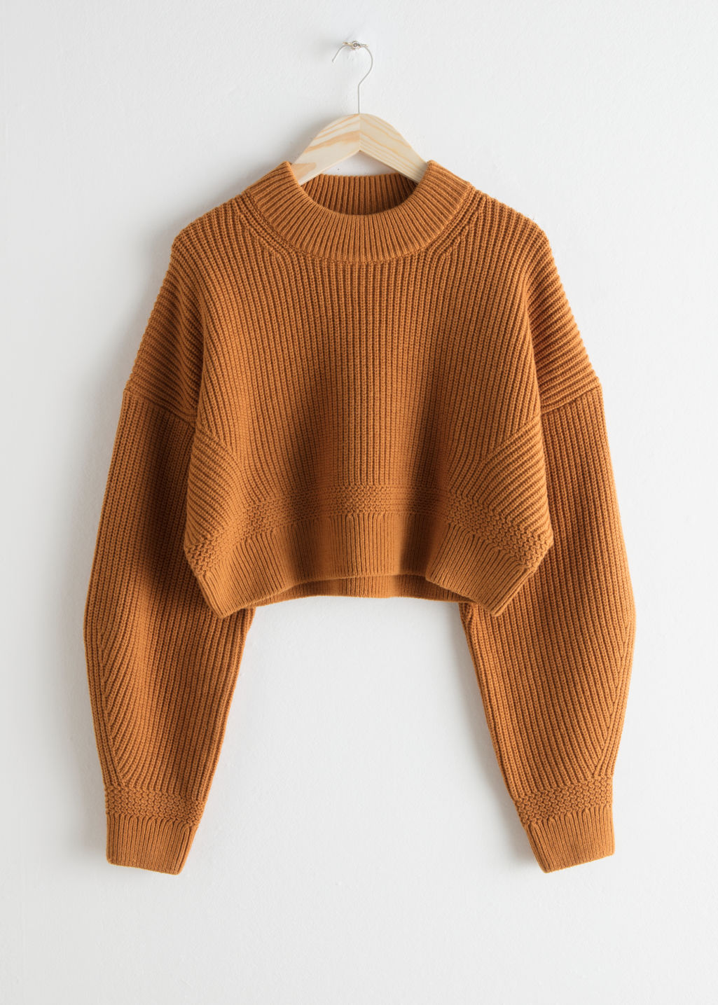 Front image of Stories cropped wool blend sweater in orange