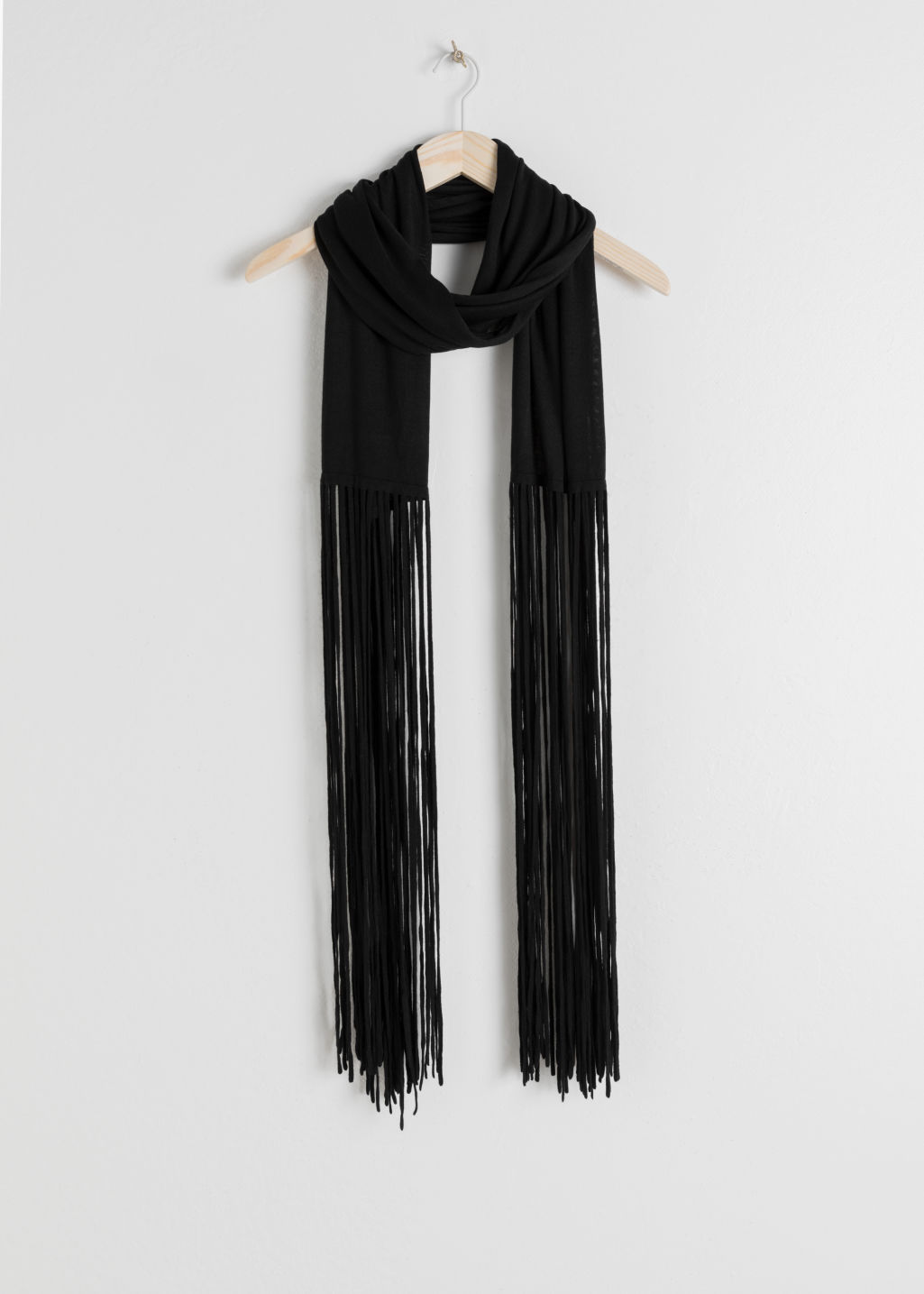 Front image of Stories merino wool fringe scarf in black