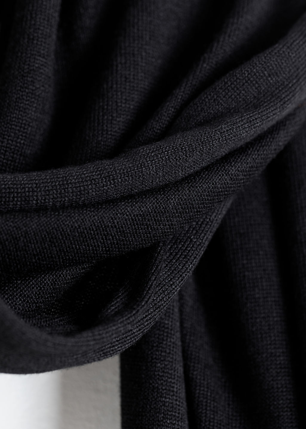 Back image of Stories merino wool fringe scarf in black