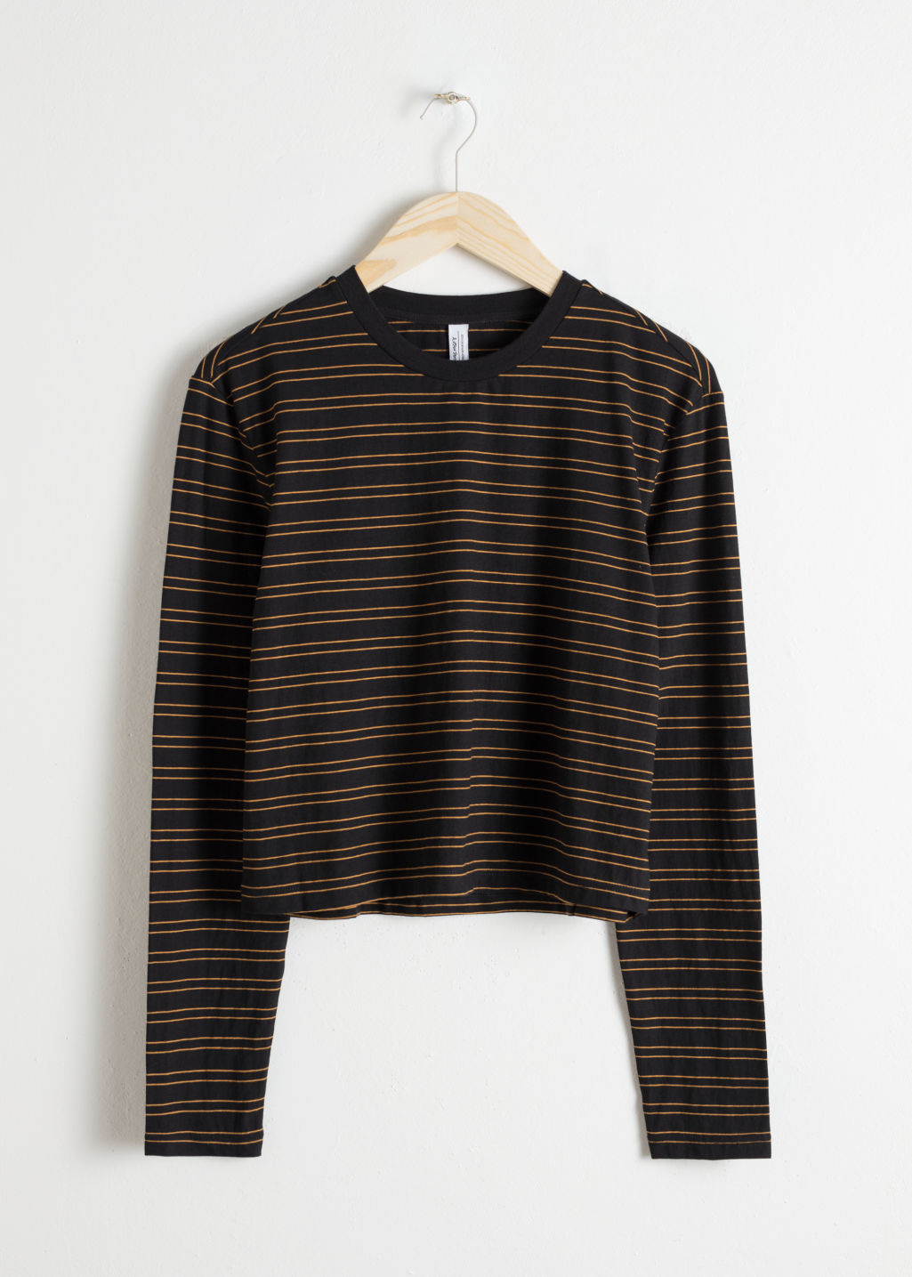 Front image of Stories long sleeve stripe tee in black