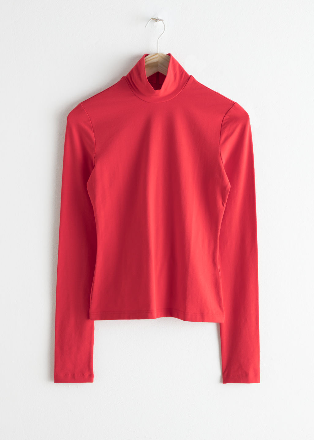 Front image of Stories stretch cotton turtleneck in red