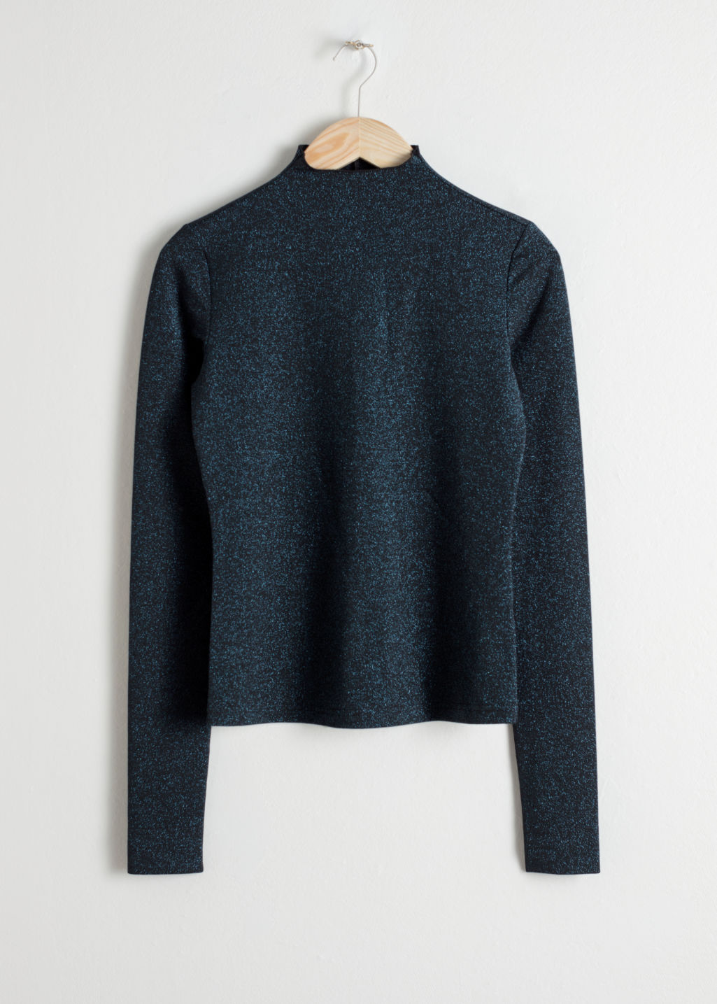 Front image of Stories long sleeve glitter turtleneck in blue