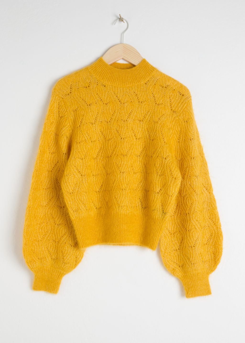 Front image of Stories eyelet knit wool blend sweater in yellow