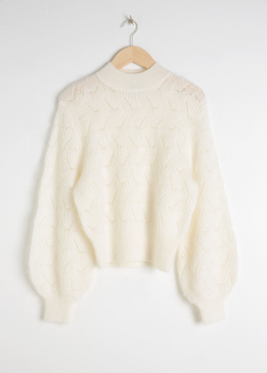 Front image of Stories eyelet knit wool blend sweater in white