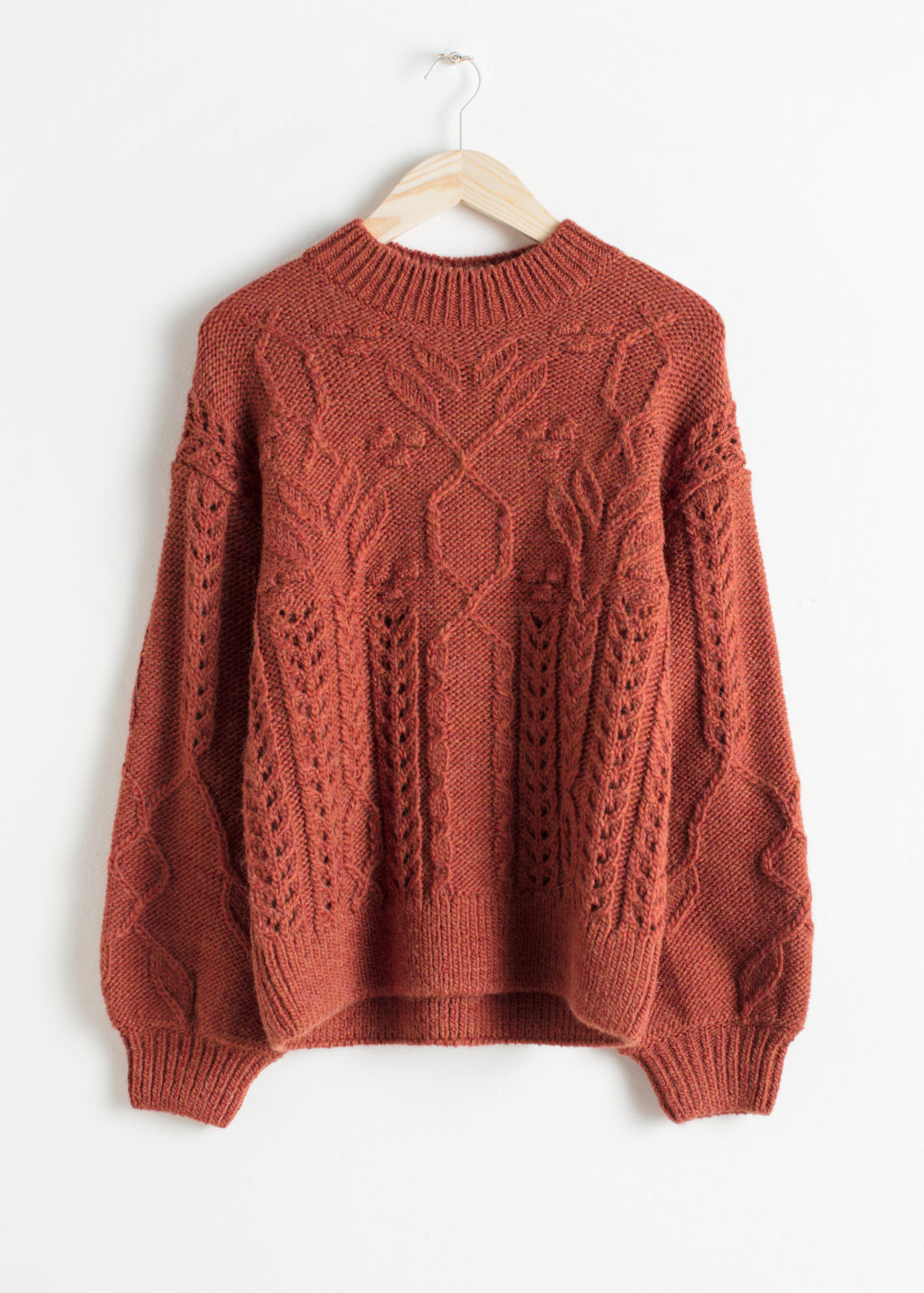 Front image of Stories floral cable knit sweater in orange