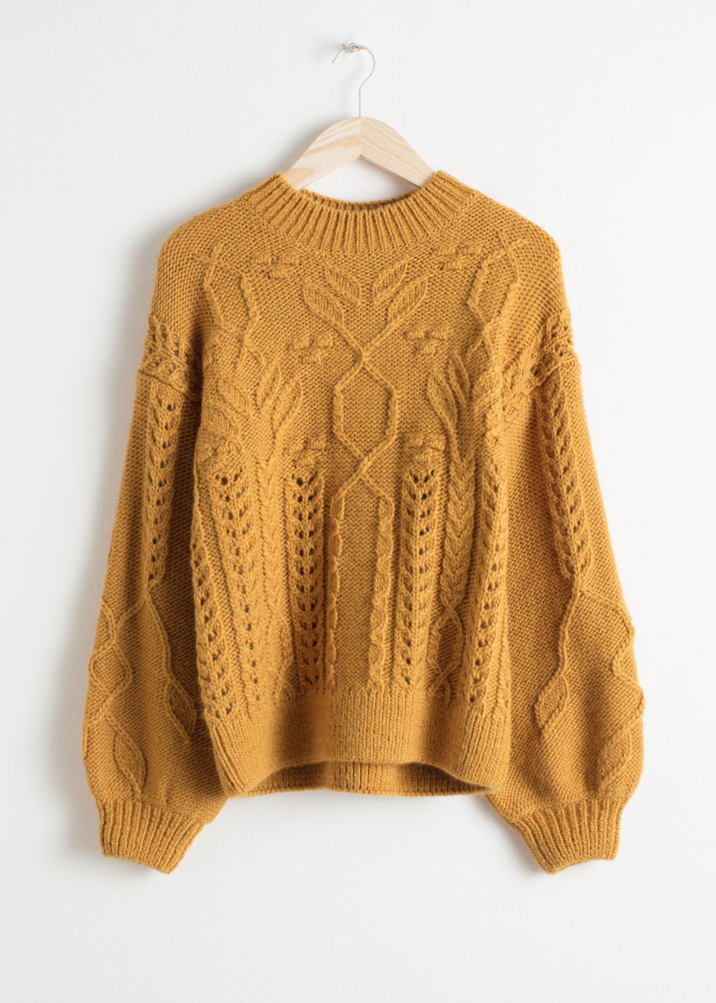 Front image of Stories floral cable knit sweater in yellow