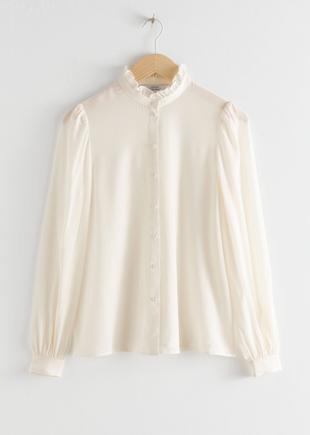 Front image of Stories ruffle collar silk shirt in white