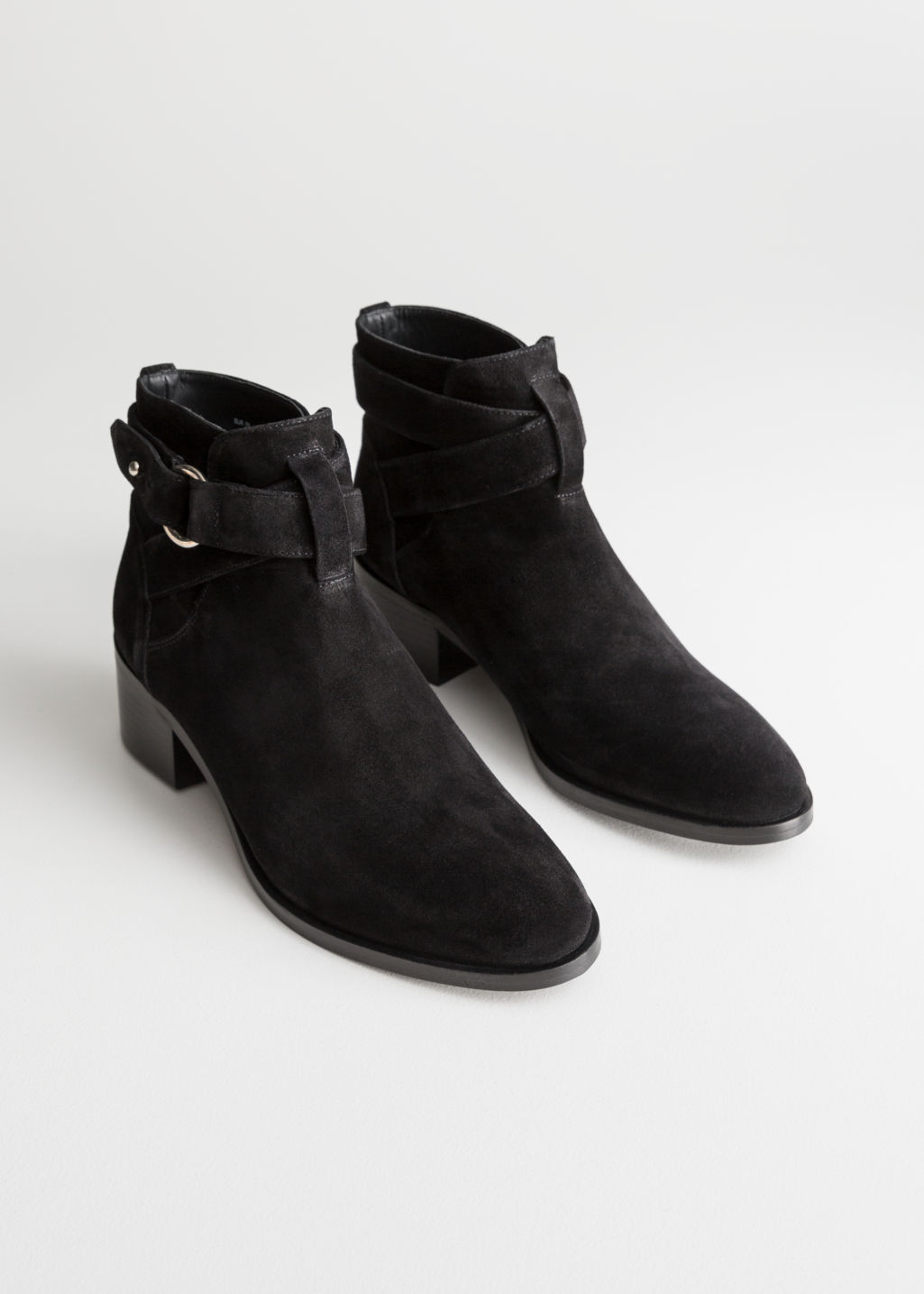 Front image of Stories heeled suede ankle boots in black