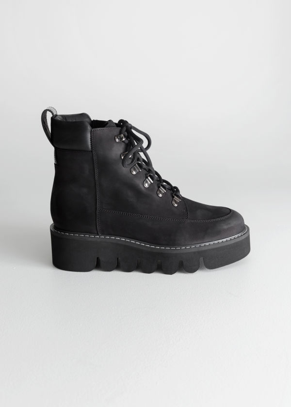Front image of Stories lace up suede boots in black