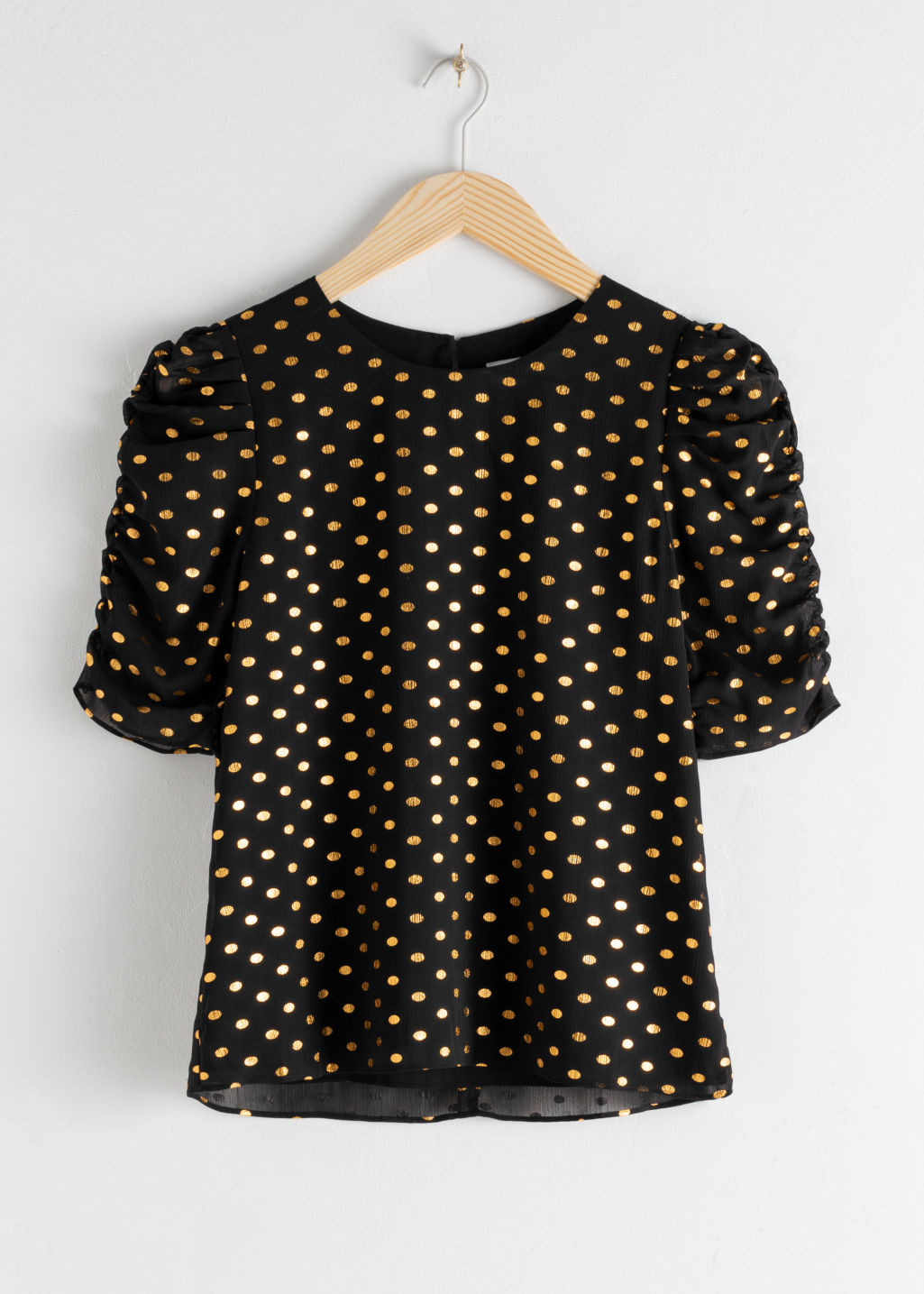Front image of Stories metallic puff sleeve blouse in black