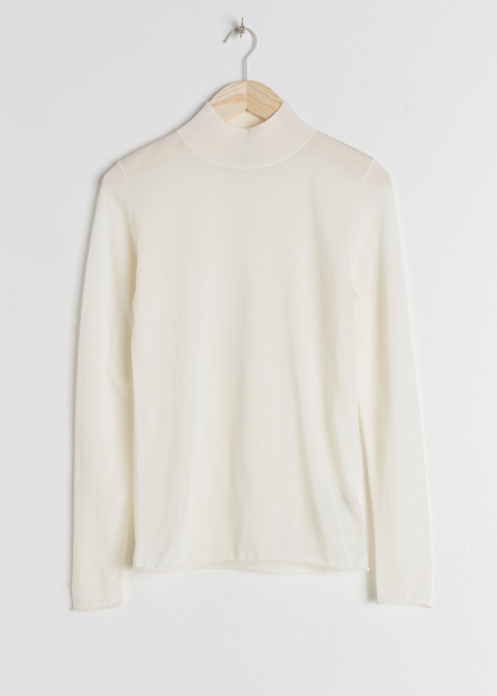 StillLife Front Image of Stories Fitted Merino Wool Turtleneck in White