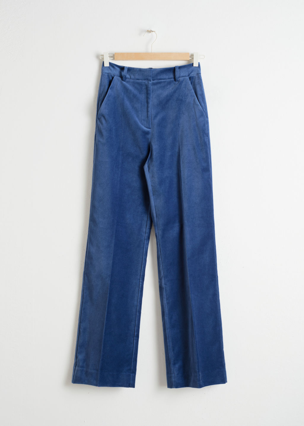 Front image of Stories high waisted velvet trousers in blue