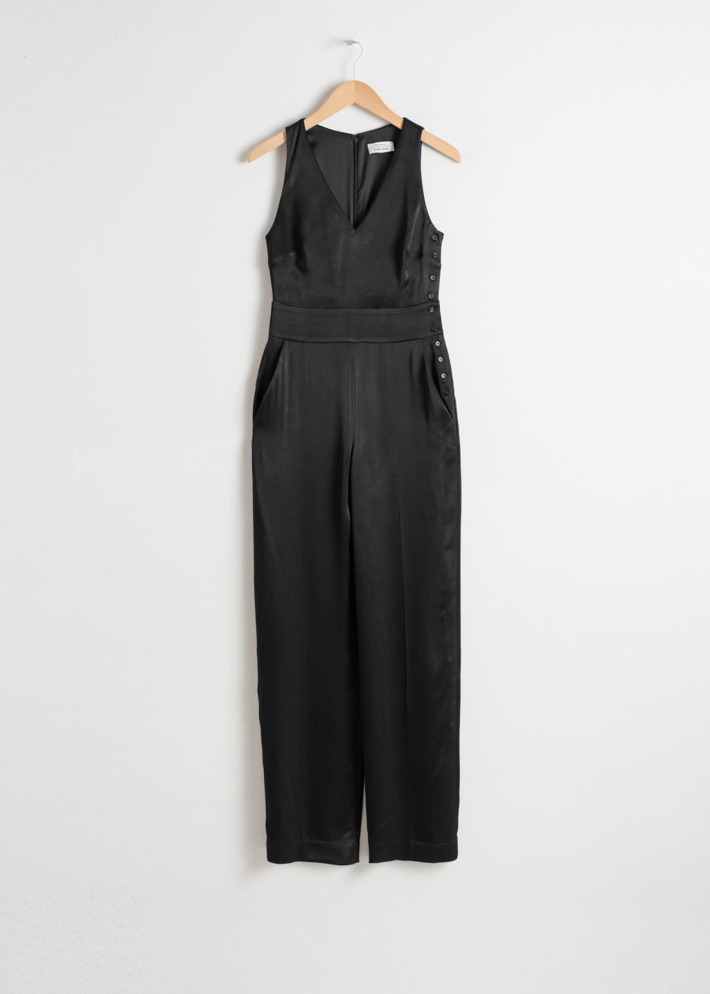 Front image of Stories sleeveless satin jumpsuit in black