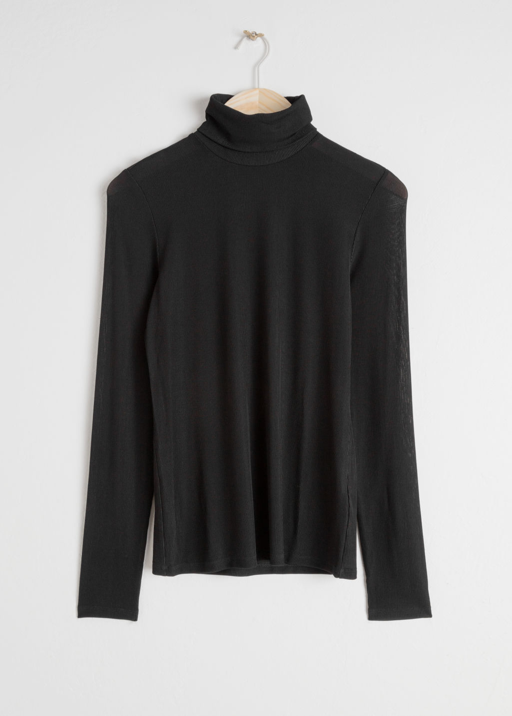 Front image of Stories ribbed fitted turtleneck in black