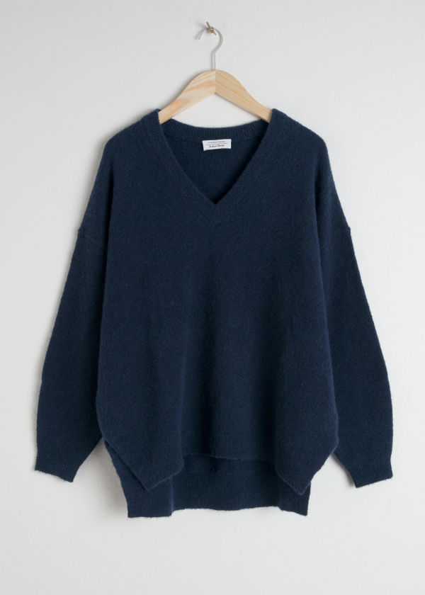 Front image of Stories v-neck oversized sweater in blue