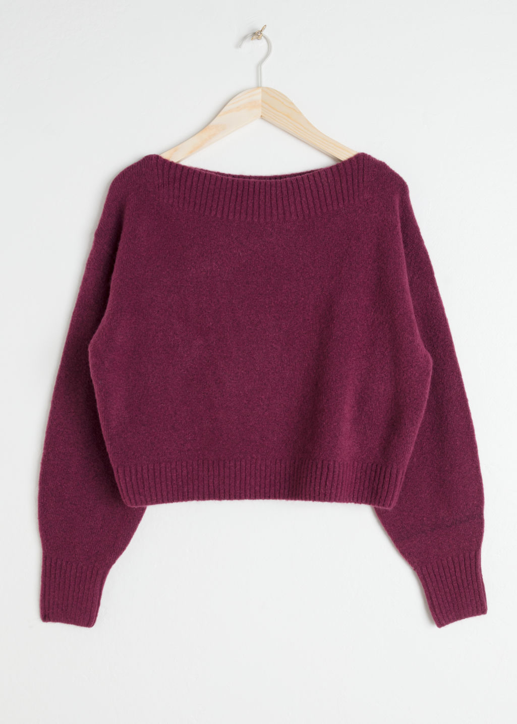 Front image of Stories boatneck knit sweater in red