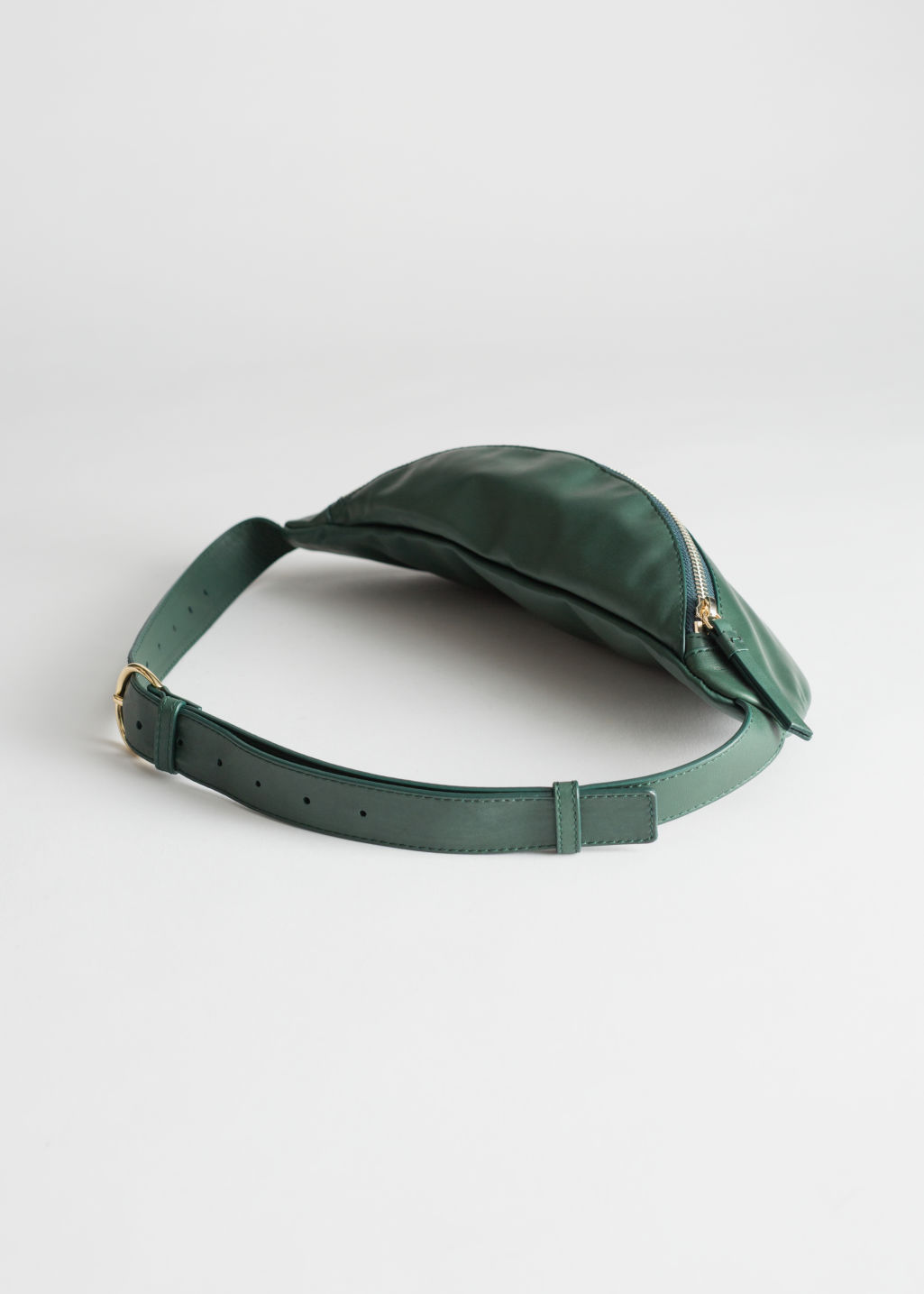 Back image of Stories leather beltbag in green