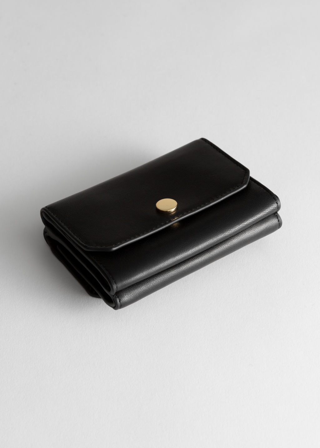 Front image of Stories leather mini wallet in black