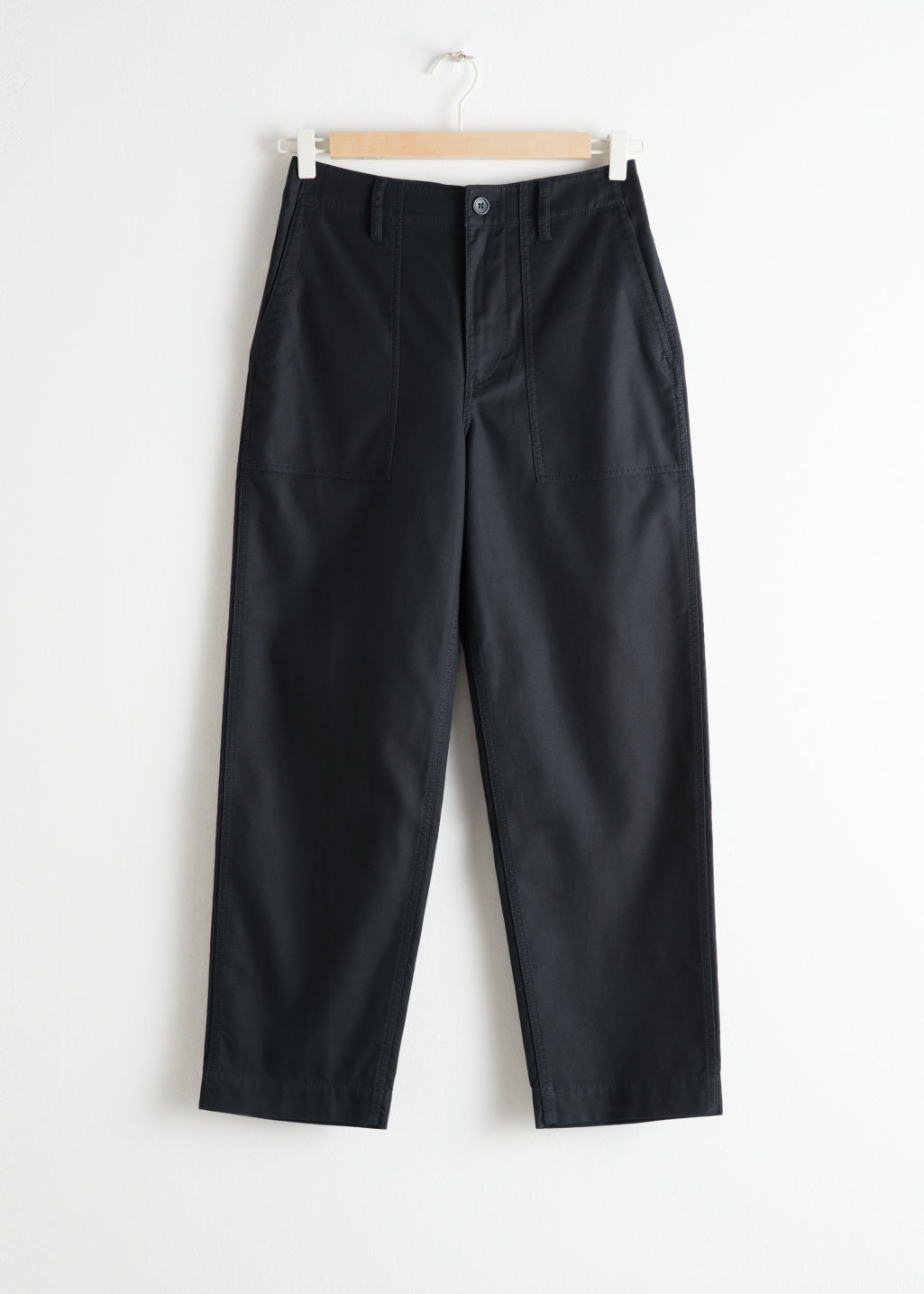 Front image of Stories cropped twill workwear trousers in black