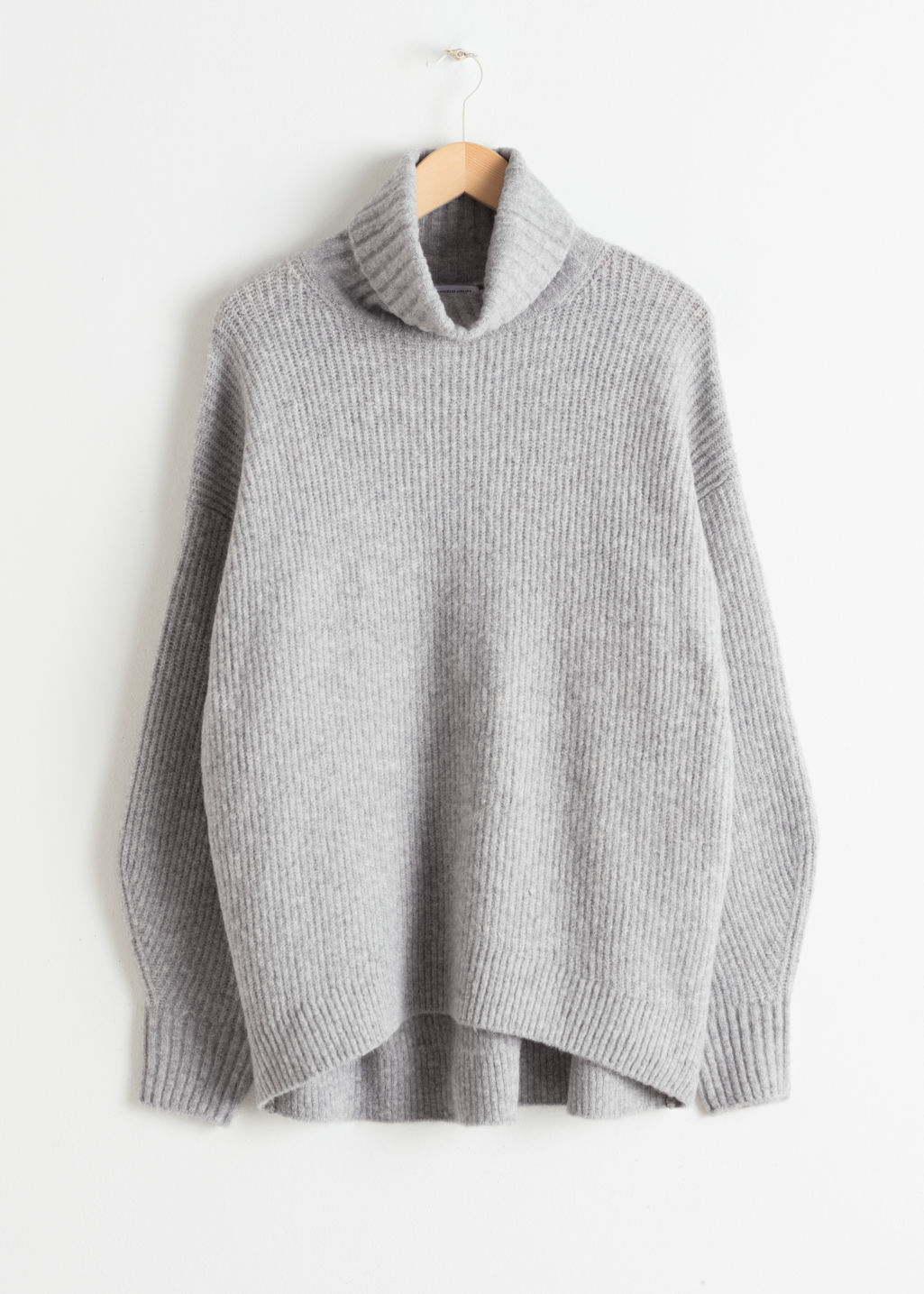 Front image of Stories oversized turtleneck sweater in grey