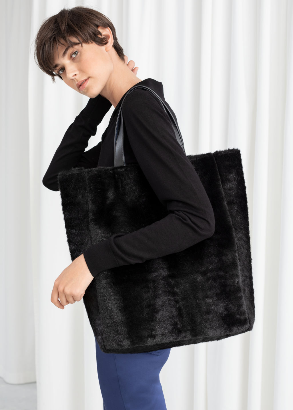 Back image of Stories large faux fur tote in black