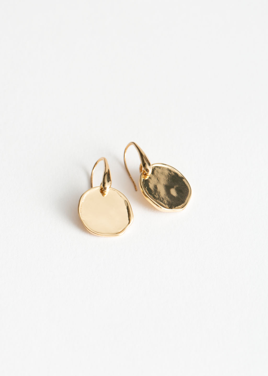 Front image of Stories circle charm hanging earrings in gold