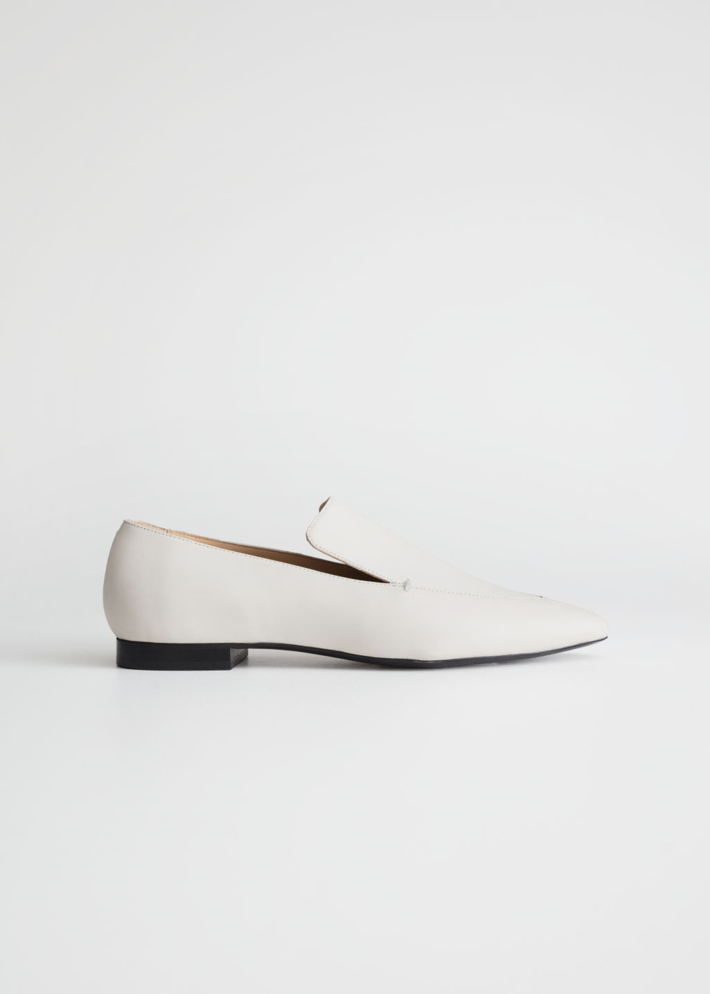 Front image of Stories pointed leather loafers in white