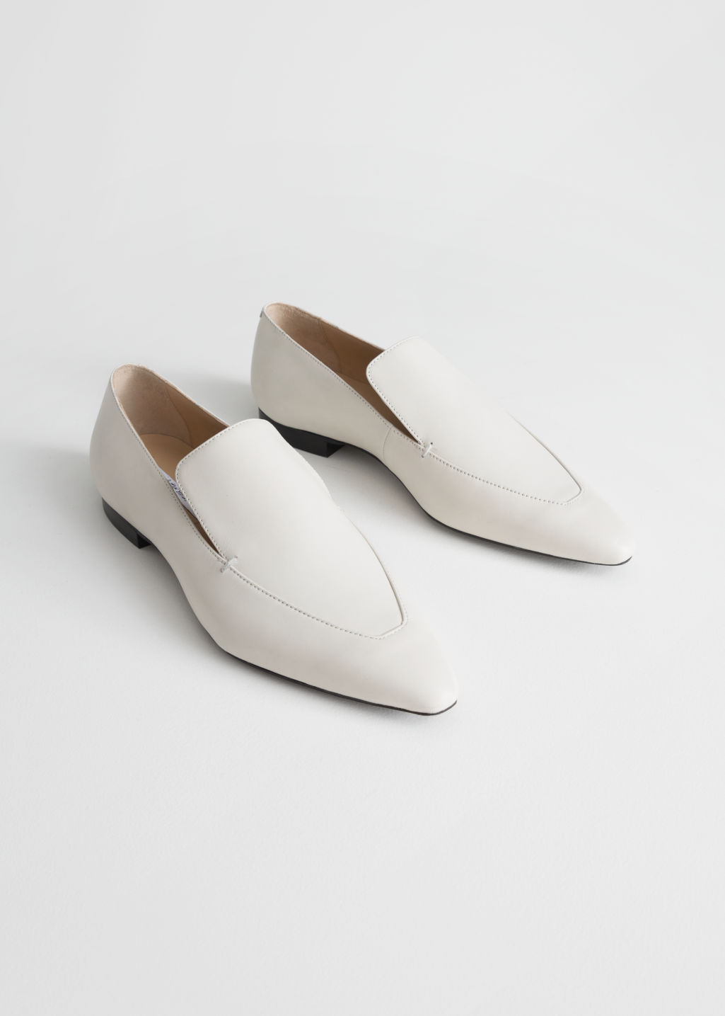 Back image of Stories pointed leather loafers in white