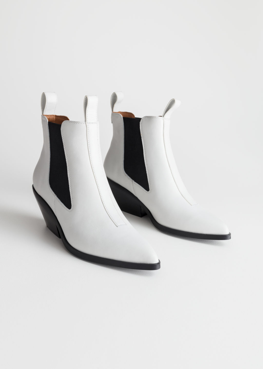 Front image of Stories low leather cowboy boots in white