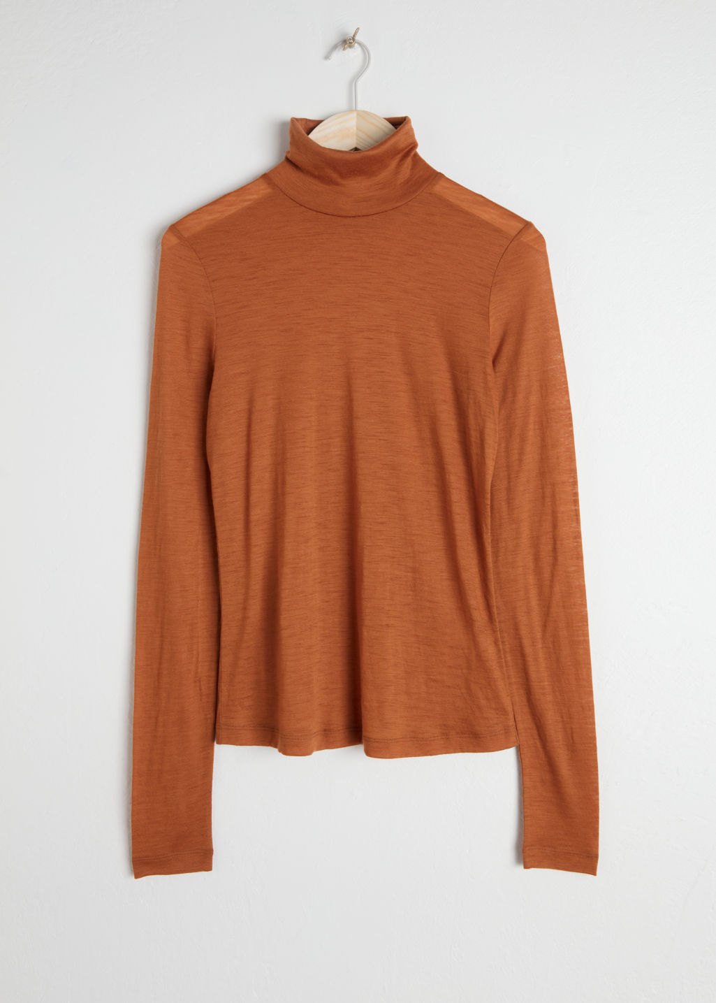 Front image of Stories thin wool knit turtleneck in orange