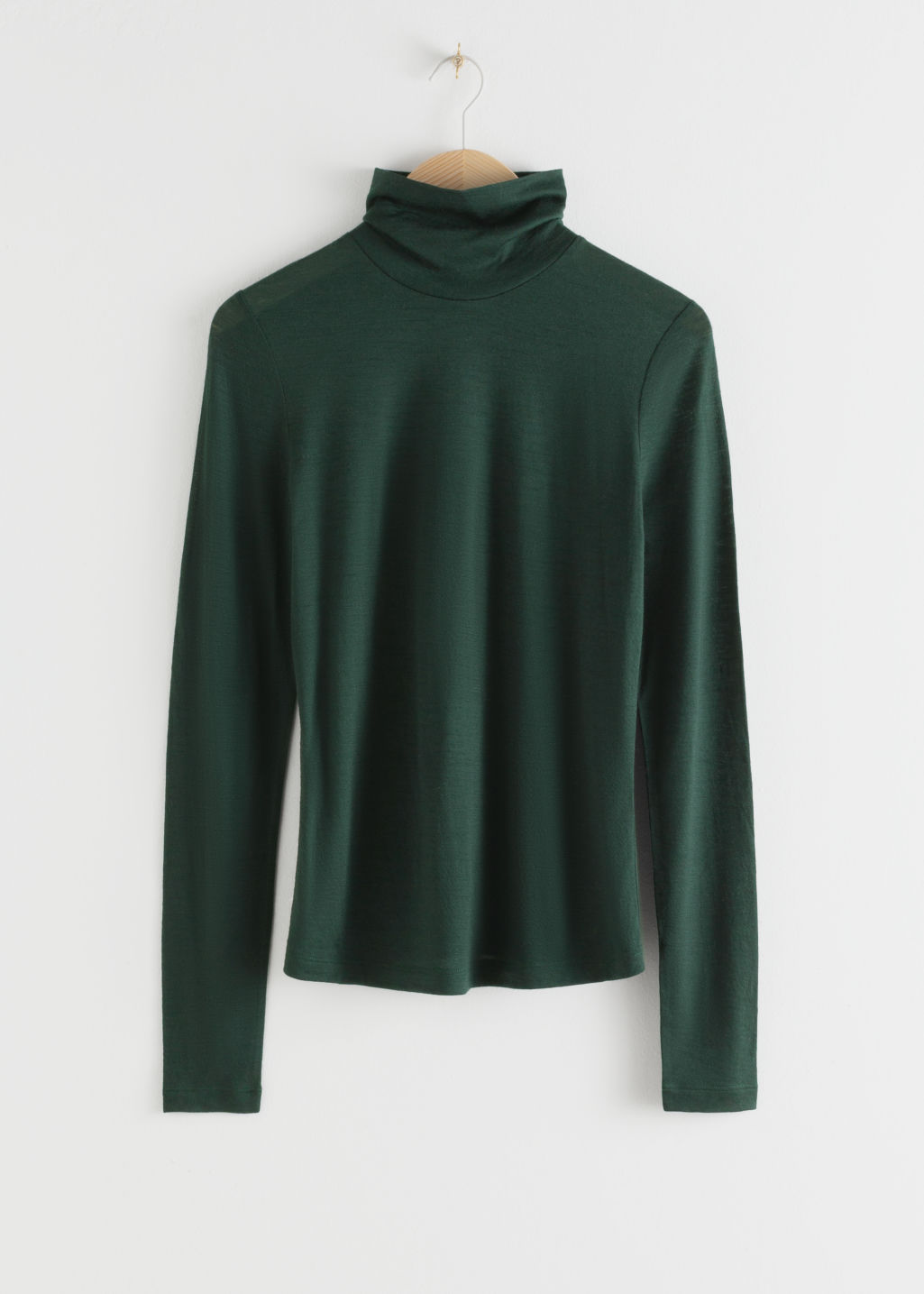 Front image of Stories thin wool knit turtleneck in green