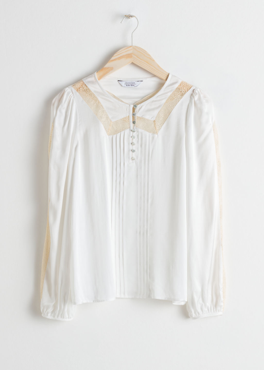 Front image of Stories lace trim blouse in white