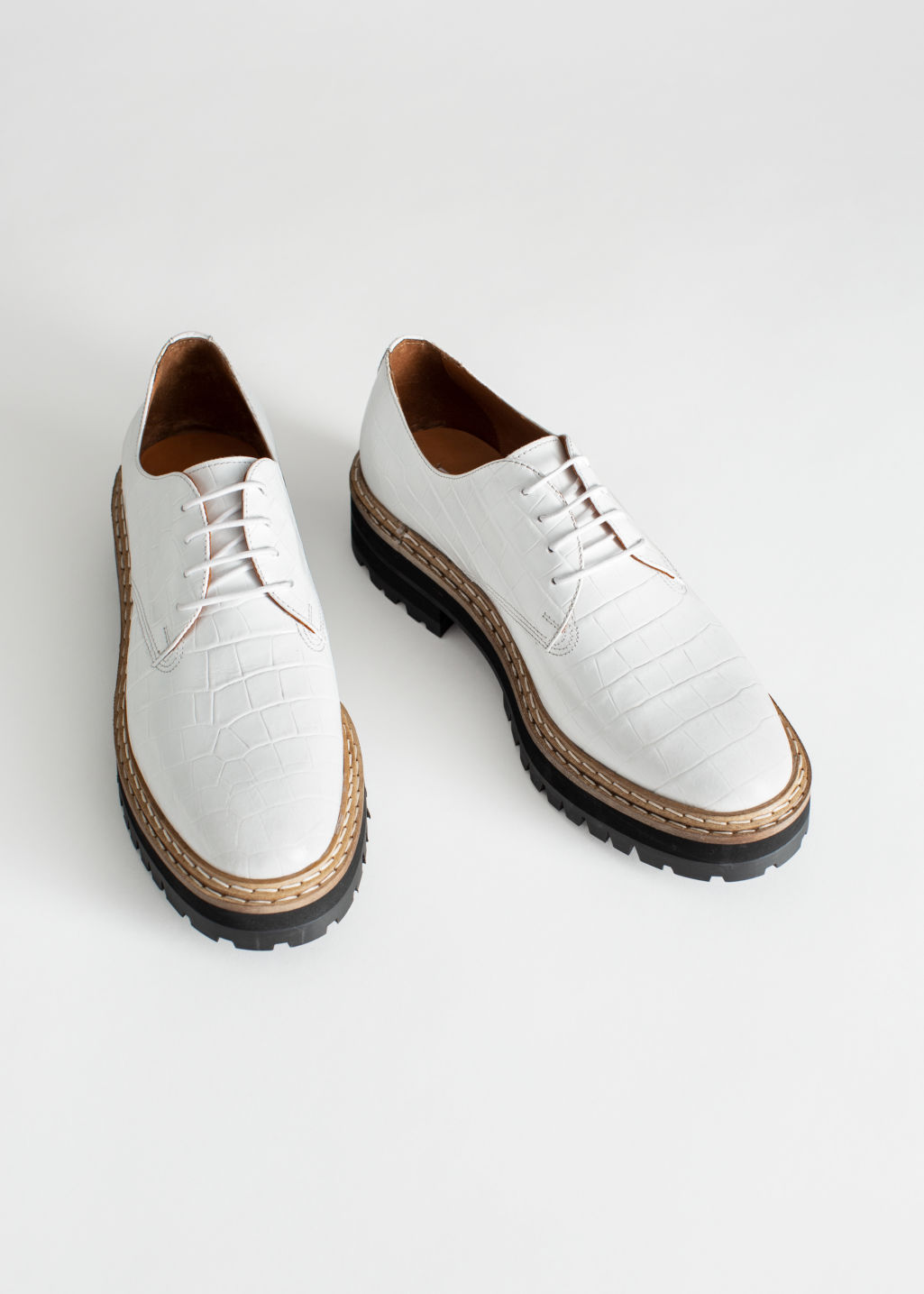 Front image of Stories platform leather croc oxfords in white