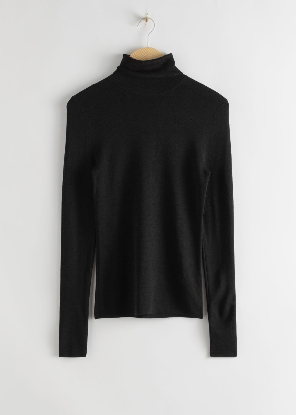 Front image of Stories merino wool turtleneck in black