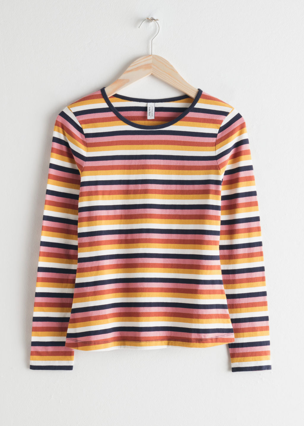 Front image of Stories long sleeve striped cotton tee in pink