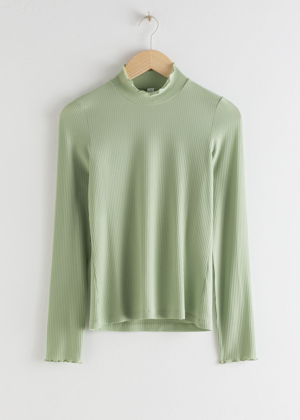 Front image of Stories fitted stretch rib mock neck top in green