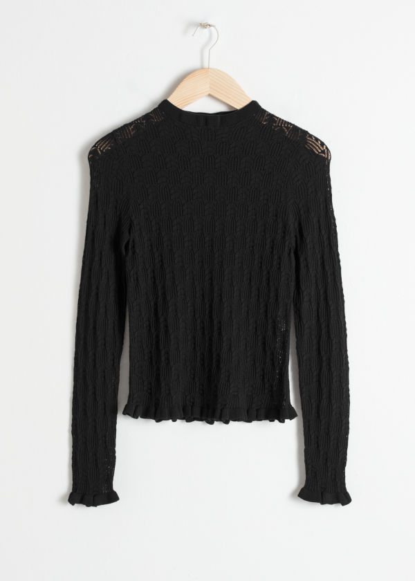 Front image of Stories eyelet knit top in black