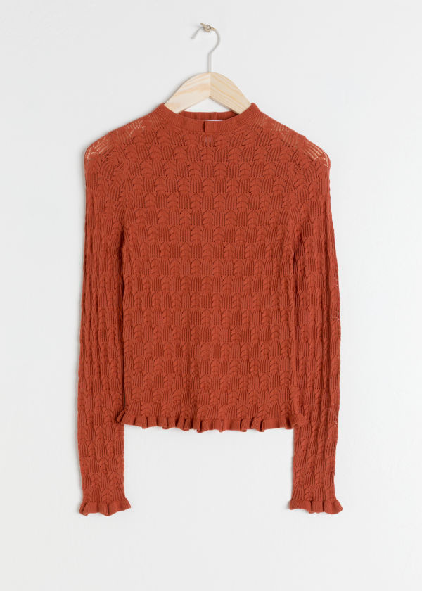 Front image of Stories eyelet knit top in red