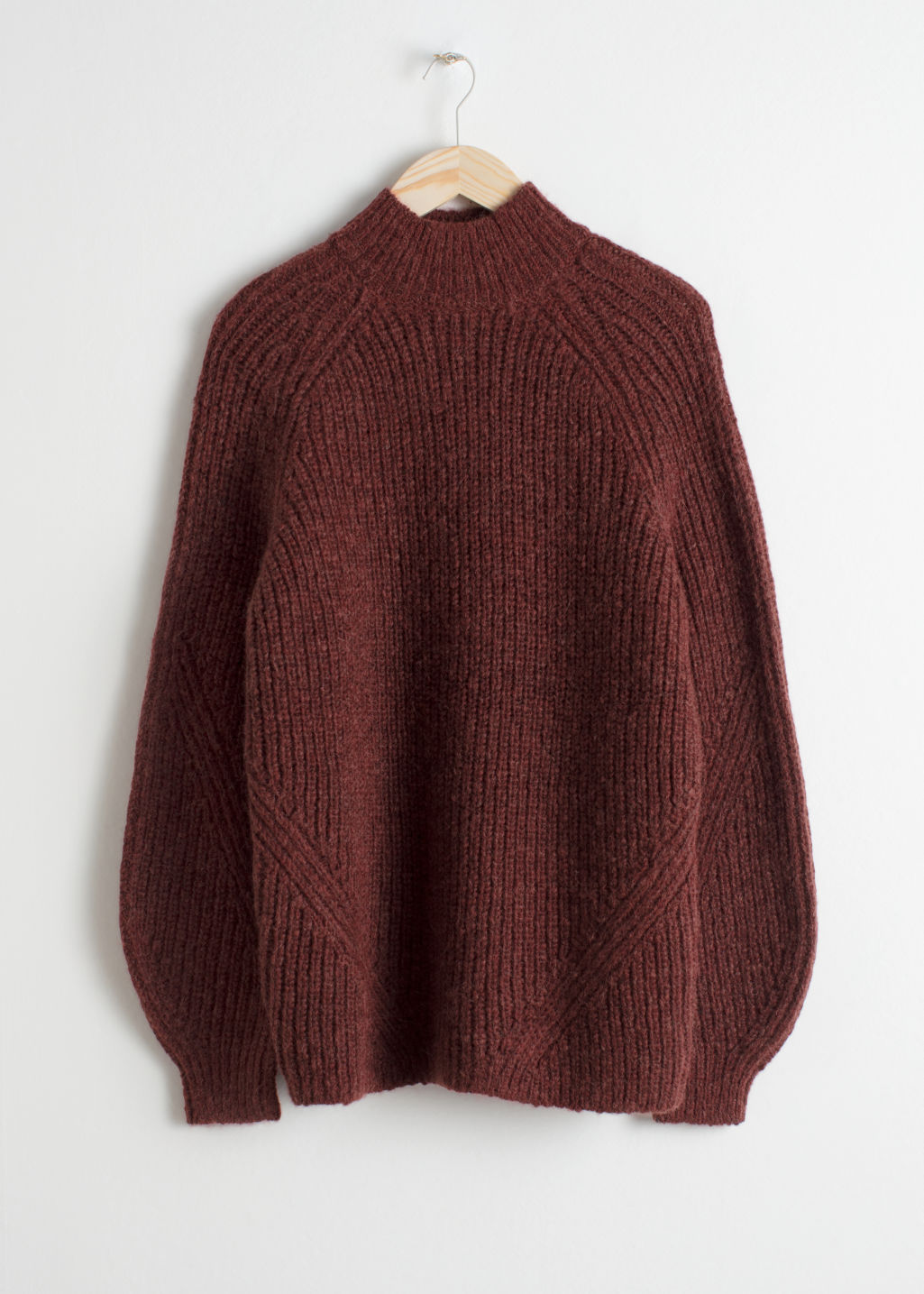 Front image of Stories oversized mock neck sweater in red