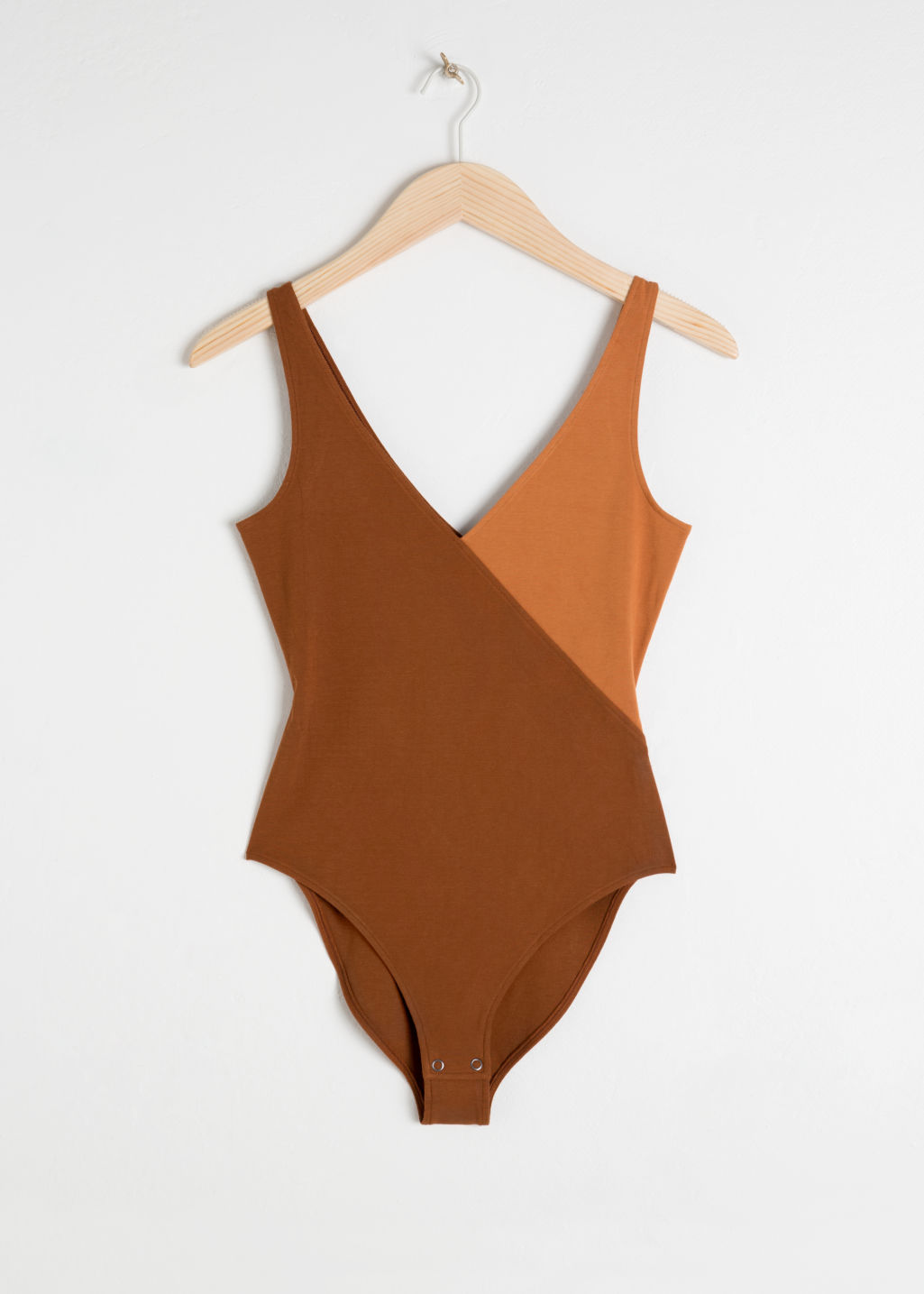 Front image of Stories diagonal colour block bodysuit in beige