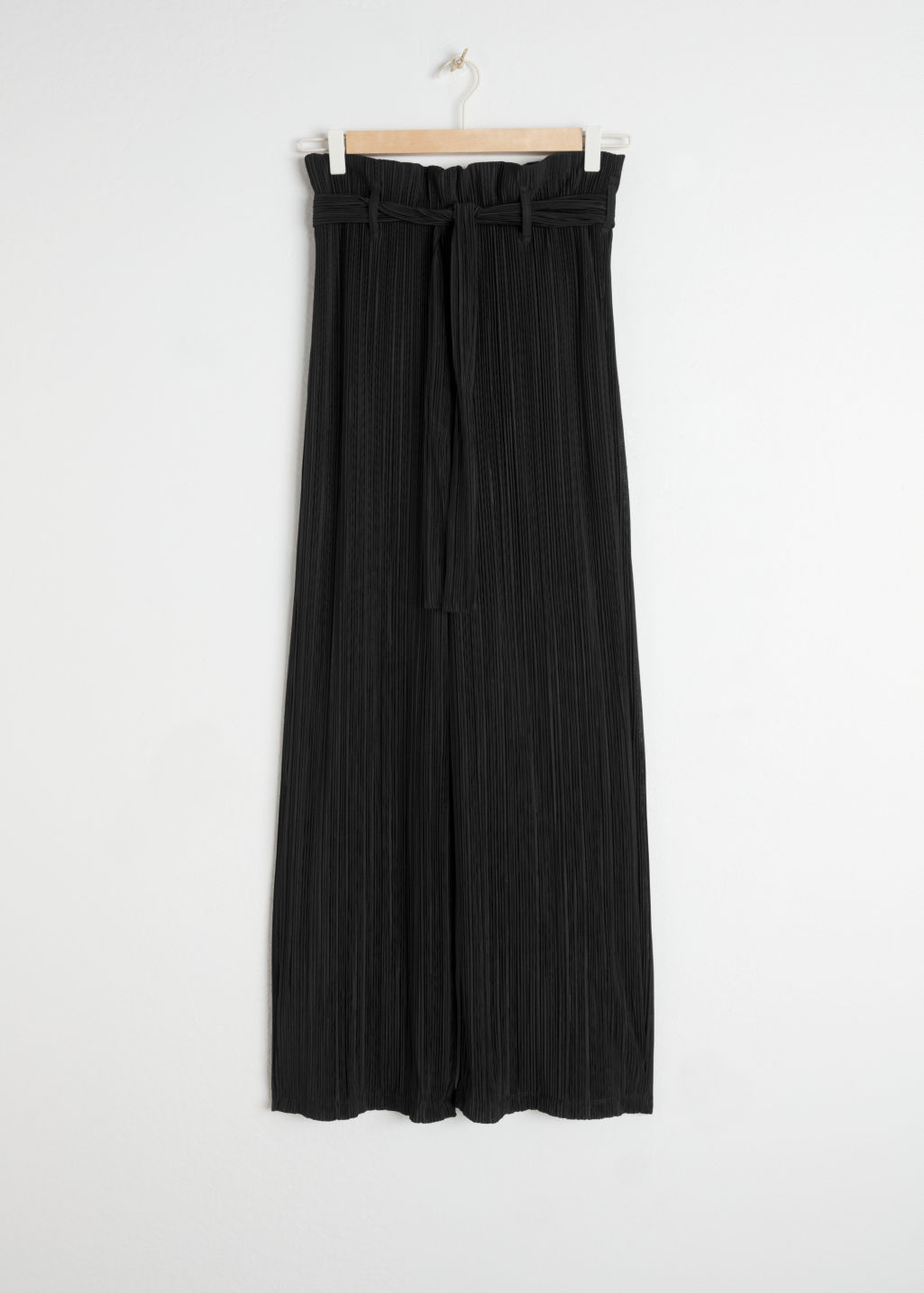 Front image of Stories belted paperbag waist trousers in black