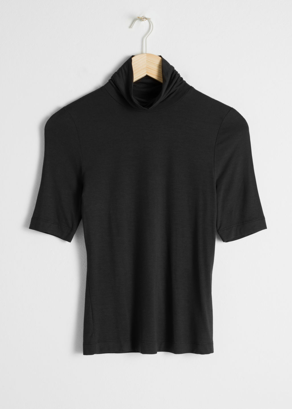 Front image of Stories short sleeve turtleneck in black