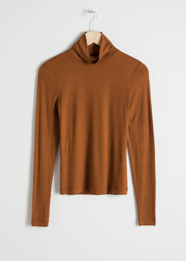 Front image of Stories fitted stretch turtleneck in beige