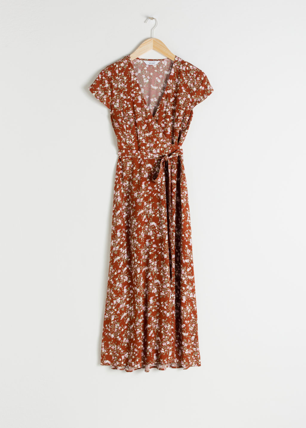 Front image of Stories floral midi wrap dress in orange